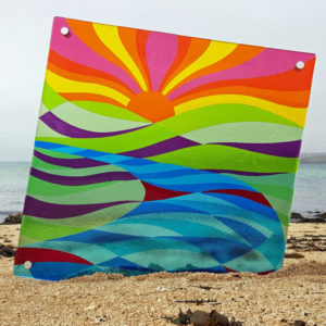 A large fused glass wall panel depicting a sunrise over hills and lakes, handmade by Connemara Blue
