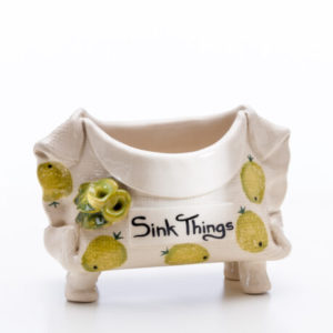 Sink Things' container is so useful for holding that sponge, cloth or scrubbing brush.
