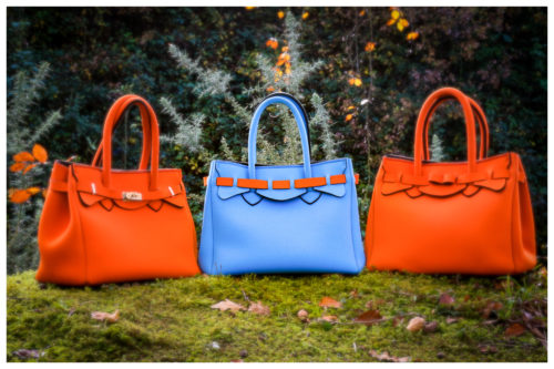 Collection of eco-friendly, neoprene handbags in bright orange and blue designed by Ruth Phelan in Ireland
