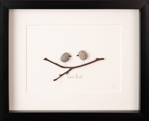 Artwork of two lovebirds made with pebbles