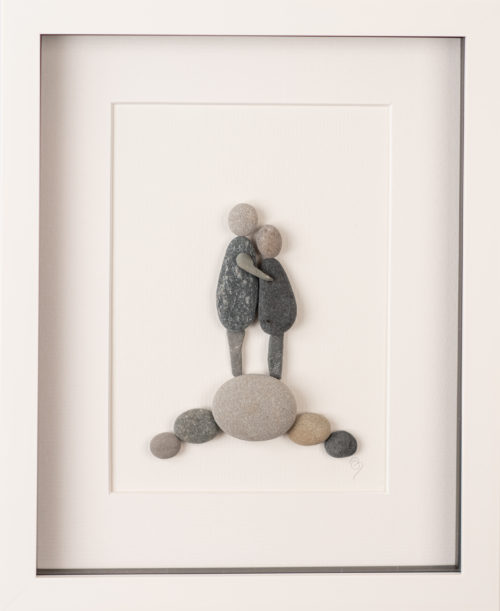Artwork of couple made with pebbles